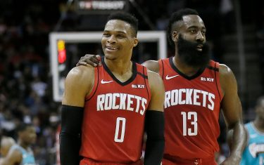 HOUSTON, TEXAS - FEBRUARY 26: Russell Westbrook #0 of the Houston Rockets is calmed down by James Harden #13 after a technical foul was called on him during the second quarter against the Memphis Grizzlies at Toyota Center on February 26, 2020 in Houston, Texas.  NOTE TO USER: User expressly acknowledges and agrees that, by downloading and/or using this photograph, user is consenting to the terms and conditions of the Getty Images License Agreement. (Photo by Bob Levey/Getty Images)