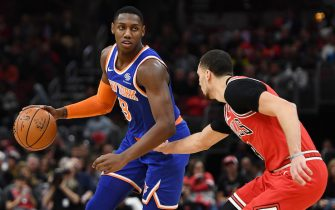 CHICAGO, ILLINOIS - NOVEMBER 12:  RJ Barrett #9 of the New York Knicks is defended by Zach LaVine #8 of the Chicago Bulls during the first half of a game at United Center on November 12, 2019 in Chicago, Illinois. NOTE TO USER: User expressly acknowledges and agrees that, by downloading and or using this photograph, User is consenting to the terms and conditions of the Getty Images License Agreement. (Photo by Stacy Revere/Getty Images)