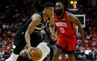 HOUSTON, TX - OCTOBER 24: Giannis Antetokounmpo #34 of the Milwaukee Bucks drives to the basket defended by James Harden #13 of the Houston Rockets in the first half at Toyota Center on October 24, 2019 in Houston, Texas. NOTE TO USER: User expressly acknowledges and agrees that, by downloading and or using this photograph, User is consenting to the terms and conditions of the Getty Images License Agreement. (Photo by Tim Warner/Getty Images)