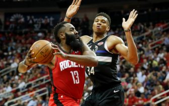 HOUSTON, TX - OCTOBER 24:  James Harden #13 of the Houston Rockets drives to the basket defended by Giannis Antetokounmpo #34 of the Milwaukee Bucks in the second half at Toyota Center on October 24, 2019 in Houston, Texas.  NOTE TO USER: User expressly acknowledges and agrees that, by downloading and or using this photograph, User is consenting to the terms and conditions of the Getty Images License Agreement.  (Photo by Tim Warner/Getty Images)