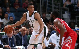 MILWAUKEE, WI - FEBRUARY 29:  Giannis Antetokounmpo #34 of the Milwaukee Bucks handles the ball against James Harden #13 of the Houston Rockets on February 29, 2016 at the BMO Harris Bradley Center in Milwaukee, Wisconsin. NOTE TO USER: User expressly acknowledges and agrees that, by downloading and or using this Photograph, user is consenting to the terms and conditions of the Getty Images License Agreement. Mandatory Copyright Notice: Copyright 2016 NBAE (Photo by Gary Dineen/NBAE via Getty Images)