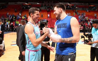 MIAMI, FL - FEBRUARY 28: Goran Dragic #7 of the Miami Heat and Luka Doncic #77 of the Dallas Mavericks embrace following the game on February 28, 2020 at American Airlines Arena in Miami, Florida. NOTE TO USER: User expressly acknowledges and agrees that, by downloading and or using this Photograph, user is consenting to the terms and conditions of the Getty Images License Agreement. Mandatory Copyright Notice: Copyright 2020 NBAE (Photo by Issac Baldizon/NBAE via Getty Images)