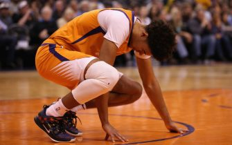 PHOENIX, ARIZONA - FEBRUARY 28: Cameron Johnson #23 of the Phoenix Suns reacts after falling hard to the court during the first half of the NBA game against the Detroit Pistons at Talking Stick Resort Arena on February 28, 2020 in Phoenix, Arizona. NOTE TO USER: User expressly acknowledges and agrees that, by downloading and or using this photograph, user is consenting to the terms and conditions of the Getty Images License Agreement. Mandatory Copyright Notice: Copyright 2020 NBAE. (Photo by Christian Petersen/Getty Images)