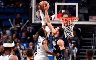 ORLANDO, FL - FEBRUARY 28: Malik Beasley #5 of the Minnesota Timberwolves is blocked by Aaron Gordon #00 of the Orlando Magic during the game on February 28, 2020 at Amway Center in Orlando, Florida. NOTE TO USER: User expressly acknowledges and agrees that, by downloading and or using this photograph, User is consenting to the terms and conditions of the Getty Images License Agreement. Mandatory Copyright Notice: Copyright 2020 NBAE (Photo by Gary Bassing/NBAE via Getty Images)