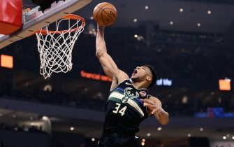MILWAUKEE, WISCONSIN - FEBRUARY 28: Giannis Antetokounmpo #34 of the Milwaukee Bucks dunks the ball in the first quarter against the Oklahoma City Thunder at the Fiserv Forum on February 28, 2020 in Milwaukee, Wisconsin. NOTE TO USER: User expressly acknowledges and agrees that, by downloading and or using this photograph, User is consenting to the terms and conditions of the Getty Images License Agreement. (Photo by Dylan Buell/Getty Images)