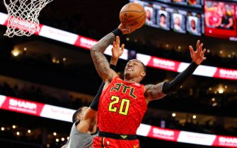 ATLANTA, GA - FEBRUARY 28: John Collins #20 of the Atlanta Hawks goes up for a shot during the first half of an NBA game against the Brooklyn Nets at State Farm Arena on February 28, 2020 in Atlanta, Georgia. NOTE TO USER: User expressly acknowledges and agrees that, by downloading and/or using this photograph, user is consenting to the terms and conditions of the Getty Images License Agreement. (Photo by Todd Kirkland/Getty Images) *** Local Caption *** John Collins