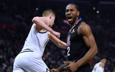 LOS ANGELES, CALIFORNIA - FEBRUARY 28:  Kawhi Leonard #2 of the LA Clippers calls for a foul behind Nikola Jokic #15 of the Denver Nuggets during the first half at Staples Center on February 28, 2020 in Los Angeles, California. (Photo by Harry How/Getty Images)