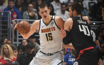 LOS ANGELES, CA - FEBRUARY 28: Nikola Jokic #15 of the Denver Nuggets handles the ball against the LA Clippers on February 28, 2020 at STAPLES Center in Los Angeles, California. NOTE TO USER: User expressly acknowledges and agrees that, by downloading and/or using this Photograph, user is consenting to the terms and conditions of the Getty Images License Agreement. Mandatory Copyright Notice: Copyright 2020 NBAE (Photo by Andrew D. Bernstein/NBAE via Getty Images)