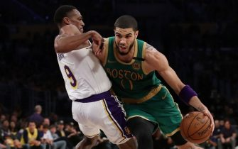 LOS ANGELES, CALIFORNIA - FEBRUARY 23: Jayson Tatum #0 of the Boston Celtics drives to the basket against Rajon Rondo #9 of the Los Angeles Lakers during the fourth quarter at Staples Center on February 23, 2020 in Los Angeles, California. The Lakers won 114-112. (Photo by Katelyn Mulcahy/Getty Images)