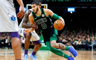 BOSTON, MASSACHUSETTS - DECEMBER 22: Jayson Tatum #0 of the Boston Celtics drives to the basket during the fourth quarter of the game against the Charlotte Hornets at TD Garden on December 22, 2019 in Boston, Massachusetts. NOTE TO USER: User expressly acknowledges and agrees that, by downloading and or using this photograph, User is consenting to the terms and conditions of the Getty Images License Agreement. (Photo by Omar Rawlings/Getty Images)