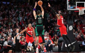 PORTLAND, OREGON - FEBRUARY 25: Jayson Tatum #0 of the Boston Celtics takes a shot against Carmelo Anthony #00 of the Portland Trail Blazers in the fourth quarter during their game at Moda Center on February 25, 2020 in Portland, Oregon. NOTE TO USER: User expressly acknowledges and agrees that, by downloading and or using this photograph, User is consenting to the terms and conditions of the Getty Images License Agreement. (Photo by Abbie Parr/Getty Images)