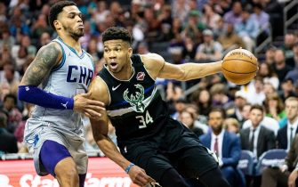 CHARLOTTE, NORTH CAROLINA - MARCH 01: Giannis Antetokounmpo #34 of the Milwaukee Bucks tries to dribble around Miles Bridges #0 of the Charlotte Hornets during the fourth quarter during their game at Spectrum Center on March 01, 2020 in Charlotte, North Carolina. NOTE TO USER: User expressly acknowledges and agrees that, by downloading and/or using this photograph, user is consenting to the terms and conditions of the Getty Images License Agreement. (Photo by Jacob Kupferman/Getty Images)