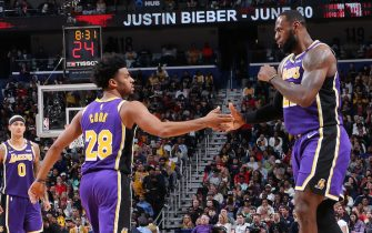 NEW ORLEANS, LA - MARCH 1: Quinn Cook #28 of the Los Angeles Lakers and LeBron James #23 of the Los Angeles Lakers high five during the game against the New Orleans Pelicans on March 1, 2020 at the Smoothie King Center in New Orleans, Louisiana. NOTE TO USER: User expressly acknowledges and agrees that, by downloading and or using this Photograph, user is consenting to the terms and conditions of the Getty Images License Agreement. Mandatory Copyright Notice: Copyright 2020 NBAE (Photo by Layne Murdoch Jr./NBAE via Getty Images)