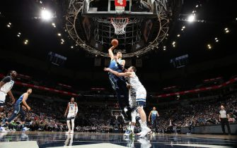 MINNEAPOLIS, MN -  MARCH 1: Kristaps Porzingis #6 of the Dallas Mavericks drives to the basket during a game against the Minnesota Timberwolves on March 1, 2020 at Target Center in Minneapolis, Minnesota. NOTE TO USER: User expressly acknowledges and agrees that, by downloading and or using this Photograph, user is consenting to the terms and conditions of the Getty Images License Agreement. Mandatory Copyright Notice: Copyright 2020 NBAE (Photo by David Sherman/NBAE via Getty Images)