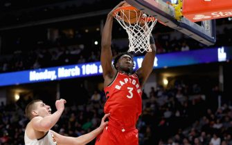 DENVER, COLORADO - MARCH 01: OG Anunoby #3 of the Toronto Raptors dunks the ball against Nikola Jokic #15 of the Denver Nuggets in the first quarter at the Pepsi Center on March 01, 2020 in Denver, Colorado. NOTE TO USER: User expressly acknowledges and agrees that, by downloading and or using this photograph, User is consenting to the terms and conditions of the Getty Images License Agreement. ( (Photo by Matthew Stockman/Getty Images)