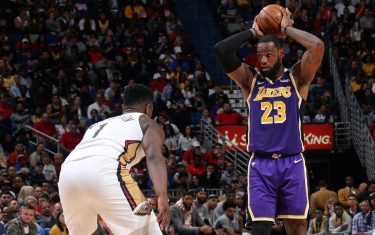 NEW ORLEANS, LA - MARCH 1: LeBron James #23 of the Los Angeles Lakers handles the ball while Zion Williamson #1 of the New Orleans Pelicans plays defense on March 1, 2020 at the Smoothie King Center in New Orleans, Louisiana. NOTE TO USER: User expressly acknowledges and agrees that, by downloading and or using this Photograph, user is consenting to the terms and conditions of the Getty Images License Agreement. Mandatory Copyright Notice: Copyright 2020 NBAE (Photo by Layne Murdoch Jr./NBAE via Getty Images)