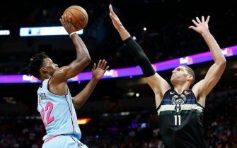 MIAMI, FLORIDA - MARCH 02:  Brook Lopez #11 of the Milwaukee Bucks defends a shot by Jimmy Butler #22 of the Miami Heat during the first half at American Airlines Arena on March 02, 2020 in Miami, Florida. NOTE TO USER: User expressly acknowledges and agrees that, by downloading and/or using this photograph, user is consenting to the terms and conditions of the Getty Images License Agreement.  (Photo by Michael Reaves/Getty Images)