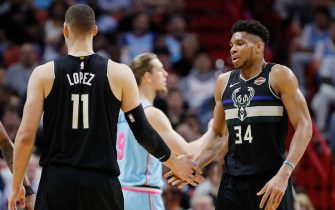 MIAMI, FLORIDA - MARCH 02:  Giannis Antetokounmpo #34 of the Milwaukee Bucks high fives Brook Lopez #11 against the Miami Heat during the second half at American Airlines Arena on March 02, 2020 in Miami, Florida. NOTE TO USER: User expressly acknowledges and agrees that, by downloading and/or using this photograph, user is consenting to the terms and conditions of the Getty Images License Agreement.  (Photo by Michael Reaves/Getty Images)