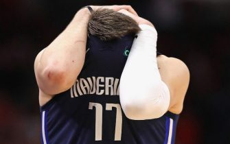 CHICAGO, ILLINOIS - MARCH 02: Luka Doncic #77 of the Dallas Mavericks reacts after missing the game-winning shot in the final seconds against the Chicago Bulls at the United Center on March 02, 2020 in Chicago, Illinois. The Bulls defeated the Mavericks 109-107. NOTE TO USER: User expressly acknowledges and agrees that, by downloading and or using this Photograph, user is consenting to the terms and conditions of the Getty Images License Agreement. (Photo by Jonathan Daniel/Getty Images)