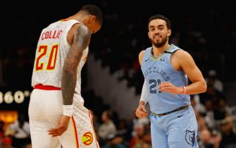 ATLANTA, GEORGIA - MARCH 02:  Tyus Jones #21 of the Memphis Grizzlies reacts after an assist for a basket against the Atlanta Hawks in the second half at State Farm Arena on March 02, 2020 in Atlanta, Georgia.  NOTE TO USER: User expressly acknowledges and agrees that, by downloading and/or using this photograph, user is consenting to the terms and conditions of the Getty Images License Agreement.  (Photo by Kevin C. Cox/Getty Images)
