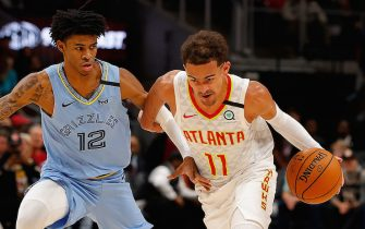 ATLANTA, GEORGIA - MARCH 02:  Trae Young #11 of the Atlanta Hawks drives against Ja Morant #12 of the Memphis Grizzlies in the first half at State Farm Arena on March 02, 2020 in Atlanta, Georgia.  NOTE TO USER: User expressly acknowledges and agrees that, by downloading and/or using this photograph, user is consenting to the terms and conditions of the Getty Images License Agreement.  (Photo by Kevin C. Cox/Getty Images)