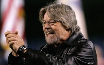 DETROIT - OCTOBER 21:  Recording artist Bob Seger acknoewledges the crowd after singing the National Anthem before the Detroit Tigers take on the St. Louis Cardinals during Game One of 2006 World Series October 21, 2006 at Comerica Park in Detroit, Michigan.  (Photo by Mark Duncan/Pool/Getty Images)