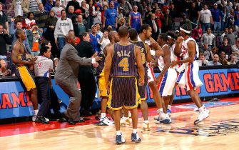 AUBURN HILLS, MI - NOVEMBER 19:  Ron Artest (L) and other members of the Indiana Pacers scuffle with members of the Detroit Pistons during a melee involving fans during a game against the Detroit Pistons November 19, 2004 at the Palace of Auburn Hills, in Auburn Hills, Michigan. NOTE TO USER: User expressly acknowledges and agrees that, by downloading and/or using this Photograph, user is consenting to the terms and conditions of the Getty Images License Agreement. Mandatory Copyright Notice: Copyright 2004 NBAE  (Photo by Allen Einstein/NBAE via Getty Images)