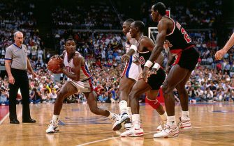 AUBURN HILLS, MI - 1990: Isiah Thomas #4 of the Detroit Pistons passes the ball during the 1990 NBA Finals circa 1990 at the Palace of Auburn Hills in Auburn Hills, Michigan. NOTE TO USER: User expressly acknowledges and agrees that, by downloading and or using this photograph, User is consenting to the terms and conditions of the Getty Images License Agreement. Mandatory Copyright Notice: Copyright 1990 NBAE (Photo by Andrew D. Bernstein/NBAE via Getty Images)