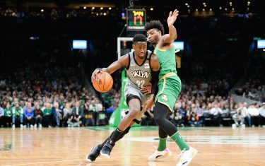 BOSTON, MA - MARCH 3: Caris LeVert #22 of the Brooklyn Nets drives past Marcus Smart #36 of the Boston Celtics in the first half at TD Garden on March 3, 2020 in Boston, Massachusetts. NOTE TO USER: User expressly acknowledges and agrees that, by downloading and or using this photograph, User is consenting to the terms and conditions of the Getty Images License Agreement. (Photo by Kathryn Riley/Getty Images)