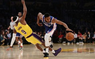 LOS ANGELES, CALIFORNIA - MARCH 03: Glenn Robinson III #40 of the Philadelphia 76ers drives against Rajon Rondo #9 of the Los Angeles Lakers during the first half at Staples Center on March 03, 2020 in Los Angeles, California. NOTE TO USER: User expressly acknowledges and agrees that, by downloading and or using this Photograph, user is consenting to the terms and conditions of the Getty Images License Agreement. (Photo by Katelyn Mulcahy/Getty Images)