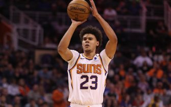 PHOENIX, ARIZONA - FEBRUARY 12:  Cameron Johnson #23 of the Phoenix Suns attempts a three point shot against the Golden State Warriors during the second half of the NBA game at Talking Stick Resort Arena on February 12, 2020 in Phoenix, Arizona. The Suns defeated the Warriors 112-106. NOTE TO USER: User expressly acknowledges and agrees that, by downloading and or using this photograph, user is consenting to the terms and conditions of the Getty Images License Agreement. Mandatory Copyright Notice: Copyright 2020 NBAE. (Photo by Christian Petersen/Getty Images)