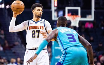 CHARLOTTE, NORTH CAROLINA - MARCH 05: Jamal Murray #27 of the Denver Nuggets is defended by Terry Rozier #3 of the Charlotte Hornets during the first quarter during their game at Spectrum Center on March 05, 2020 in Charlotte, North Carolina. NOTE TO USER: User expressly acknowledges and agrees that, by downloading and/or using this photograph, user is consenting to the terms and conditions of the Getty Images License Agreement. (Photo by Jacob Kupferman/Getty Images)