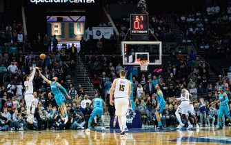 CHARLOTTE, NORTH CAROLINA - MARCH 05: Jamal Murray #27 of the Denver Nuggets makes the game winning shot in the final seconds of the fourth quarter during their game against the Charlotte Hornets at Spectrum Center on March 05, 2020 in Charlotte, North Carolina. The Denver Nuggets defeated the Charlotte Hornets 114-112. NOTE TO USER: User expressly acknowledges and agrees that, by downloading and/or using this photograph, user is consenting to the terms and conditions of the Getty Images License Agreement. (Photo by Jacob Kupferman/Getty Images)