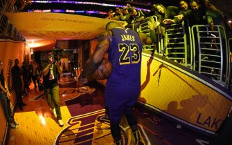 LOS ANGELES, CA - NOVEMBER 14: LeBron James #23 of the Los Angeles Lakers shakes hands with fans as he walks off the court after the game against the Portland Trail Blazers on November 14, 2018 at STAPLES Center in Los Angeles, California. NOTE TO USER: User expressly acknowledges and agrees that, by downloading and/or using this Photograph, user is consenting to the terms and conditions of the Getty Images License Agreement. Mandatory Copyright Notice: Copyright 2018 NBAE (Photo by Andrew D. Bernstein/NBAE via Getty Images)