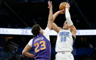 ORLANDO, FLORIDA - DECEMBER 04:  Aaron Gordon #00 of the Orlando Magic shots over Cameron Johnson #23 of the Phoenix Suns during the first half at Amway Center on December 04, 2019 in Orlando, Florida. NOTE TO USER: User expressly acknowledges and agrees that, by downloading and/or using this photograph, user is consenting to the terms and conditions of the Getty Images License Agreement. (Photo by Michael Reaves/Getty Images)
