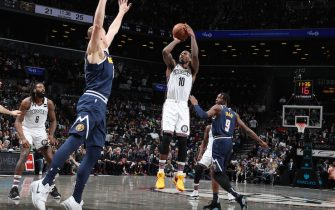 BROOKLYN, NY - DECEMBER 8: Iman Shumpert #10 of the Brooklyn Nets shoots the ball during a game against the Denver Nuggets on December 8, 2019 at Barclays Center in Brooklyn, New York. NOTE TO USER: User expressly acknowledges and agrees that, by downloading and or using this Photograph, user is consenting to the terms and conditions of the Getty Images License Agreement. Mandatory Copyright Notice: Copyright 2019 NBAE (Photo by Nathaniel S. Butler/NBAE via Getty Images)