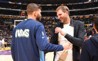 LOS ANGELES, CA - DECEMBER 1: Maxi Kleber #42 of the Dallas Mavericks and NBA Legend, Dirk Nowitzki  shake hands during the game against the Los Angeles Lakers on December 1, 2019 at STAPLES Center in Los Angeles, California. NOTE TO USER: User expressly acknowledges and agrees that, by downloading and/or using this Photograph, user is consenting to the terms and conditions of the Getty Images License Agreement. Mandatory Copyright Notice: Copyright 2019 NBAE (Photo by Andrew D. Bernstein/NBAE via Getty Images)