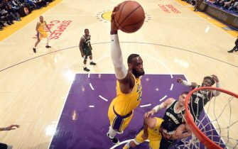 LOS ANGELES, CA - MARCH 6: LeBron James #23 of the Los Angeles Lakers dunks the ball during the game against the Milwaukee Bucks on March 6, 2020 at STAPLES Center in Los Angeles, California. NOTE TO USER: User expressly acknowledges and agrees that, by downloading and/or using this Photograph, user is consenting to the terms and conditions of the Getty Images License Agreement. Mandatory Copyright Notice: Copyright 2020 NBAE (Photo by Andrew D. Bernstein/NBAE via Getty Images)