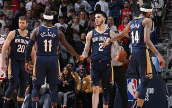 NEW ORLEANS, LA - MARCH 6: Lonzo Ball #2 of the New Orleans Pelicans high-fives Jrue Holiday #11 of the New Orleans Pelicans and Brandon Ingram #14 of the New Orleans Pelicans on March 6, 2020 at the Smoothie King Center in New Orleans, Louisiana. NOTE TO USER: User expressly acknowledges and agrees that, by downloading and or using this Photograph, user is consenting to the terms and conditions of the Getty Images License Agreement. Mandatory Copyright Notice: Copyright 2020 NBAE (Photo by Layne Murdoch Jr./NBAE via Getty Images)
