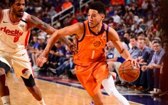 PHOENIX, AZ - MARCH 6:  Devin Booker #1 of the Phoenix Suns handles the ball against the Portland Trail Blazers on March 6, 2020 at Talking Stick Resort Arena in Phoenix, Arizona. NOTE TO USER: User expressly acknowledges and agrees that, by downloading and or using this photograph, user is consenting to the terms and conditions of the Getty Images License Agreement. Mandatory Copyright Notice: Copyright 2020 NBAE (Photo by Barry Gossage/NBAE via Getty Images)