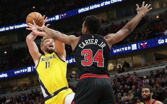 CHICAGO, ILLINOIS - MARCH 06: Domantas Sabonis #11 of the Indiana Pacers is fouled while shooting by Wendell Carter Jr. #34 of the Chicago Bulls at the United Center on March 06, 2020 in Chicago, Illinois. The Pacers defeated the Bulls 108-102. NOTE TO USER: User expressly acknowledges and agrees that, by downloading and or using this photograph, User is consenting to the terms and conditions of the Getty Images License Agreement. (Photo by Jonathan Daniel/Getty Images)