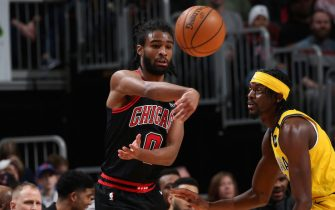 CHICAGO, IL - March 6: Coby White #0 of the Chicago Bulls passes the ball against the Indiana Pacers on March 6, 2020 at the United Center in Chicago, Illinois. NOTE TO USER: User expressly acknowledges and agrees that, by downloading and or using this photograph, user is consenting to the terms and conditions of the Getty Images License Agreement.  Mandatory Copyright Notice: Copyright 2020 NBAE (Photo by Gary Dineen/NBAE via Getty Images)