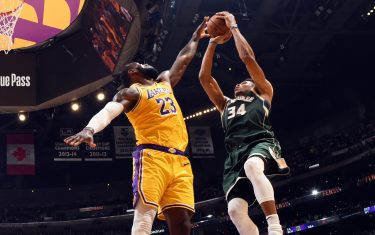 LOS ANGELES, CA - MARCH 6: Giannis Antetokounmpo #34 of the Milwaukee Bucks shoots the ball while LeBron James #23 of the Los Angeles Lakers plays defense during the game on March 6, 2020 at STAPLES Center in Los Angeles, California. NOTE TO USER: User expressly acknowledges and agrees that, by downloading and/or using this Photograph, user is consenting to the terms and conditions of the Getty Images License Agreement. Mandatory Copyright Notice: Copyright 2020 NBAE (Photo by Andrew D. Bernstein/NBAE via Getty Images)