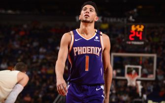 PHOENIX, AZ - MARCH 8: Devin Booker #1 of the Phoenix Suns looks on during the game against the Milwaukee Bucks on March 8, 2020 at Talking Stick Resort Arena in Phoenix, Arizona. NOTE TO USER: User expressly acknowledges and agrees that, by downloading and or using this photograph, user is consenting to the terms and conditions of the Getty Images License Agreement. Mandatory Copyright Notice: Copyright 2020 NBAE (Photo by Barry Gossage/NBAE via Getty Images)