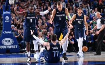 DALLAS, TX - MARCH 8: Tim Hardaway Jr. #11, Kristaps Porzingis #6 and Luka Doncic #77 react to a play during the game against the Indiana Pacers on March 8, 2020 at the American Airlines Center in Dallas, Texas. NOTE TO USER: User expressly acknowledges and agrees that, by downloading and or using this photograph, User is consenting to the terms and conditions of the Getty Images License Agreement. Mandatory Copyright Notice: Copyright 2020 NBAE (Photo by Glenn James/NBAE via Getty Images)