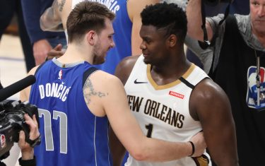 DALLAS, TX - MARCH 4: Luka Doncic #77 of the Dallas Mavericks hugs Zion Williamson #1 of the New Orleans Pelicans after the game on March 4, 2020 at the American Airlines Center in Dallas, Texas. NOTE TO USER: User expressly acknowledges and agrees that, by downloading and or using this photograph, User is consenting to the terms and conditions of the Getty Images License Agreement. Mandatory Copyright Notice: Copyright 2020 NBAE (Photo by Joe Murphy/NBAE via Getty Images)