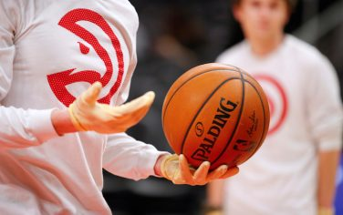 ATLANTA, GA - MARCH 09:  Ballboys wear gloves while handling warmup basketballs as a precautionary measure prior to an NBA game between the Charlotte Hornets and Atlanta Hawks at State Farm Arena on March 9, 2020 in Atlanta, Georgia. NOTE TO USER: User expressly acknowledges and agrees that, by downloading and/or using this photograph, user is consenting to the terms and conditions of the Getty Images License Agreement. (Photo by Todd Kirkland/Getty Images) *** Local Caption ***