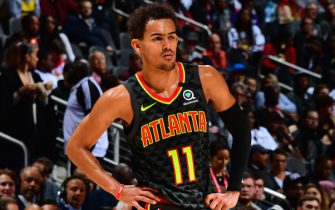 ATLANTA, GA - MARCH 9: Trae Young #11 of the Atlanta Hawks looks on during the game against the Charlotte Hornets on March 9, 2020 at State Farm Arena in Atlanta, Georgia.  NOTE TO USER: User expressly acknowledges and agrees that, by downloading and/or using this Photograph, user is consenting to the terms and conditions of the Getty Images License Agreement. Mandatory Copyright Notice: Copyright 2020 NBAE (Photo by Scott Cunningham/NBAE via Getty Images)