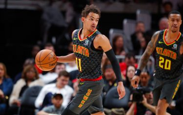 ATLANTA, GA - MARCH 09: Trae Young #11 of the Atlanta Hawks controls the ball during the first half of an NBA game against the Charlotte Hornets at State Farm Arena on March 9, 2020 in Atlanta, Georgia. NOTE TO USER: User expressly acknowledges and agrees that, by downloading and/or using this photograph, user is consenting to the terms and conditions of the Getty Images License Agreement. (Photo by Todd Kirkland/Getty Images) *** Local Caption *** Trae Young