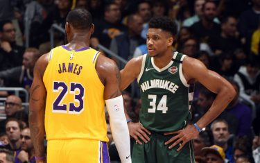LOS ANGELES, CA - MARCH 6: LeBron James #23 of the Los Angeles Lakers and Giannis Antetokounmpo #34 of the Milwaukee Bucks look on during the game on March 6, 2020 at STAPLES Center in Los Angeles, California. NOTE TO USER: User expressly acknowledges and agrees that, by downloading and/or using this Photograph, user is consenting to the terms and conditions of the Getty Images License Agreement. Mandatory Copyright Notice: Copyright 2020 NBAE (Photo by Andrew D. Bernstein/NBAE via Getty Images)